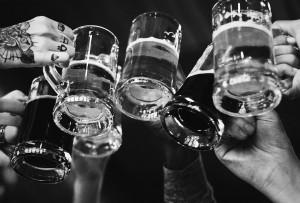 Multiple beer mugs doing a cheers