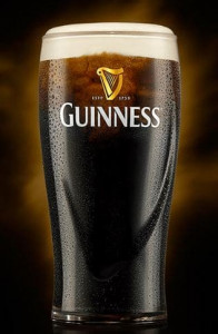 Picture of a pint glass filled to the brim with Guinness