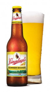 Leinenkugel's Summer Shandy beer bottle and pint glass.