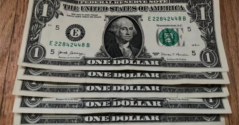 five one dollar bills
